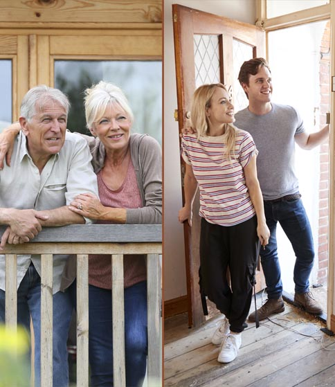 Excited Young Couple Opening Front Door Of New Home